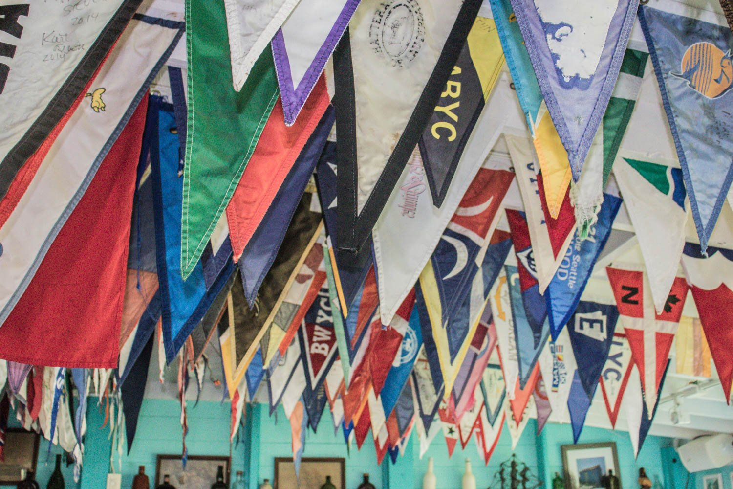 Staniel Cay Yacht Club Bar and restaurant has many yacht and sailing flags adorning the ceilings of the bar. The Staniel Cay Yacht club is also a top Exuma Hotel.