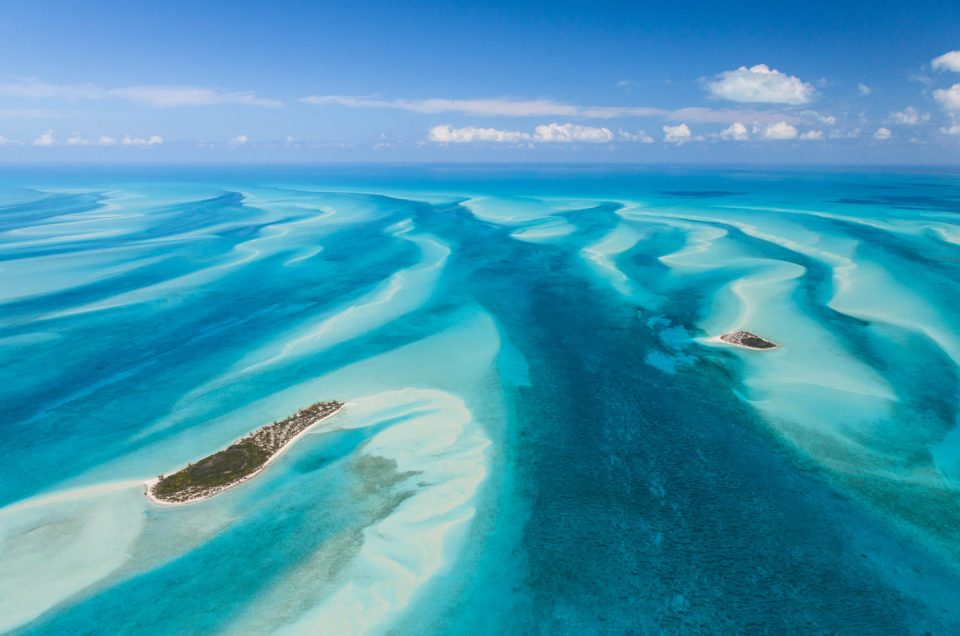 Crystal clear waters of a Day trip to Bahamas from Miami Exuma Cays from above. You can't get these views on a Miami to Bahamas ferry.