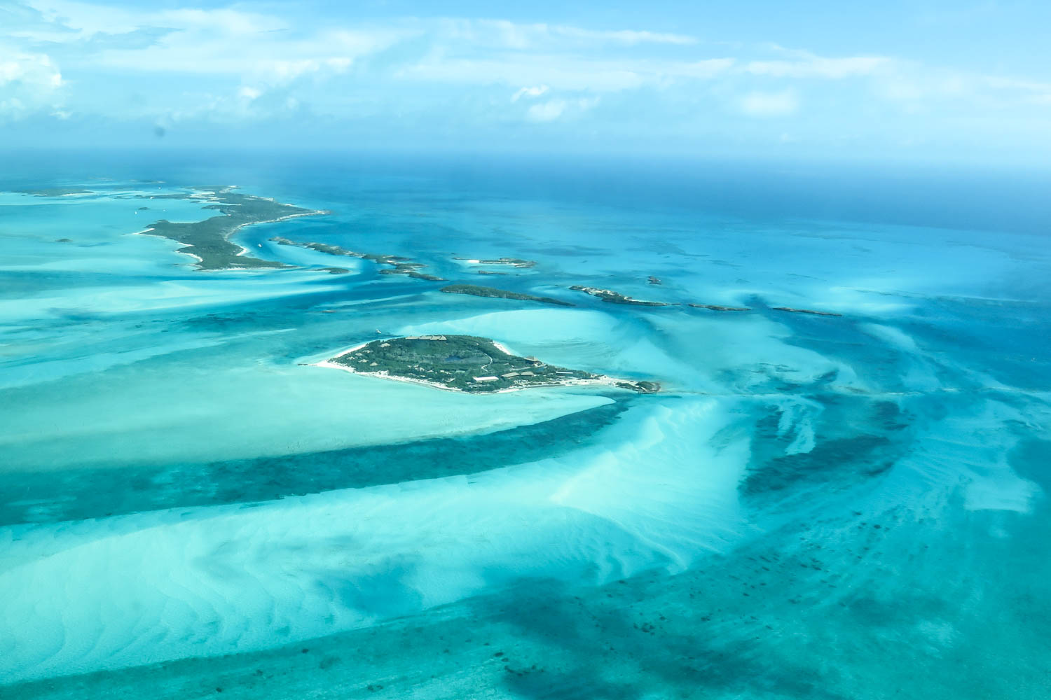 Pig Island tours from Nassau to Exuma. Fly over the stunning Exuma Cays chain of islands on a pig beach excursion from Nassau by Plane. Pig Beach is called Big Major Cay island and located in the Exuma Cays Bahamas.